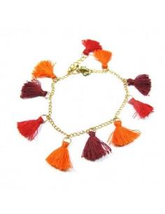 bracelet à pompons rouges et oranges