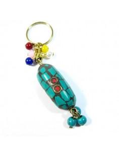 porte-clé en résine turquoise et rouge