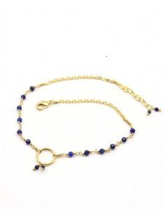 Chaîne de cheville fine dorée et perles bleues